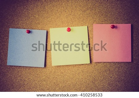 blank note papers on a cork board - stock photo