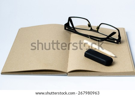 Blank Note , Pencil, eraser and glasse on  the white background - stock photo