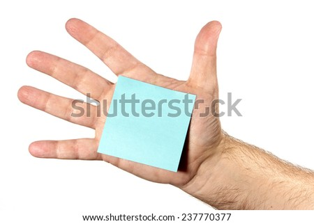 Blank Note Stuck On Hand With Copy Space - stock photo