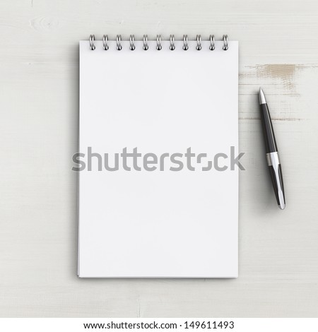 blank notebook on a white wooden table - stock photo