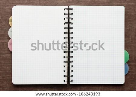 Blank notebook on desk - stock photo