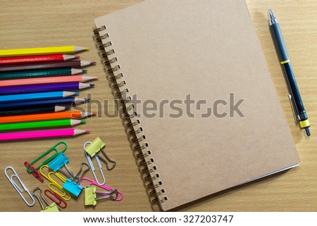 Blank notebook on school and frame of colorful school supplies.with Text Space - stock photo