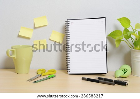 blank notebook on wooden table - stock photo