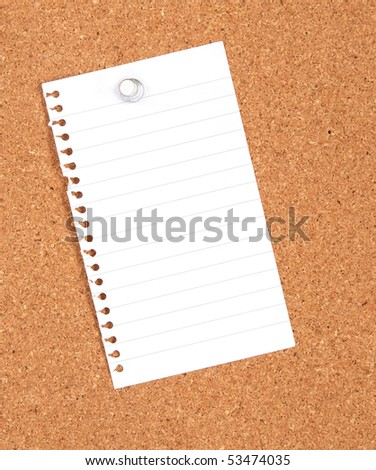 blank notebook page pinned to a corkboard - stock photo