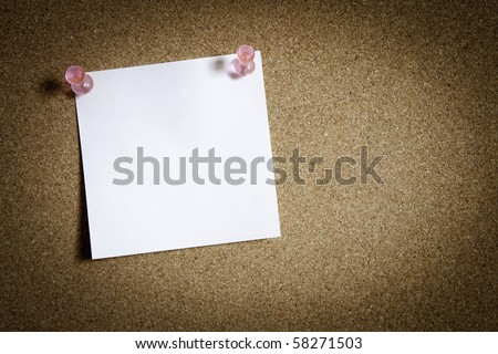 blank notepad on cork board - stock photo