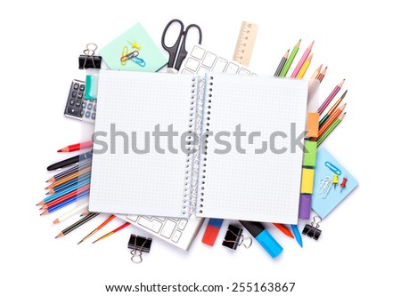 Blank notepad over school and office supplies on office table. Isolated on white background. Top view with copy space - stock photo