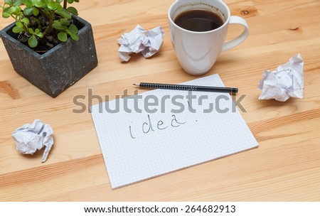 Blank notepad with pencil and coffee on wooden desk - stock photo