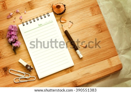 Blank notepad with  pencil on wooden table , overhead shot or Top view - stock photo