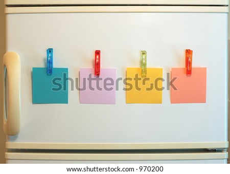 Blank notes on fridge - stock photo