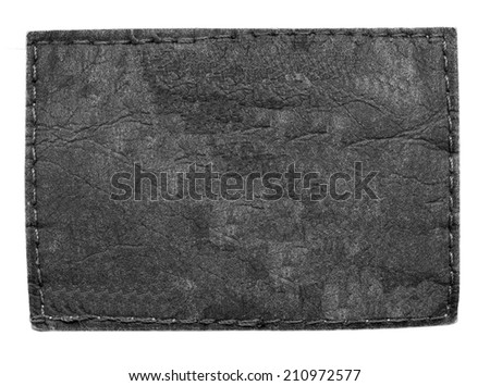 blank old  black leather jeans label  on white background - stock photo