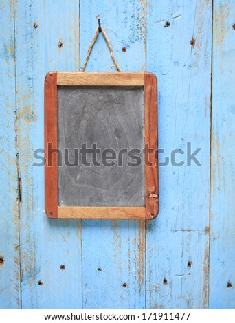 blank old blackboard, on weathered wooden wall,free copy space - stock photo
