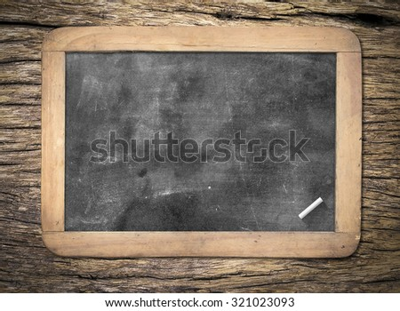 Blank old wooden blackboard or dirty slate board with white chalk. - stock photo