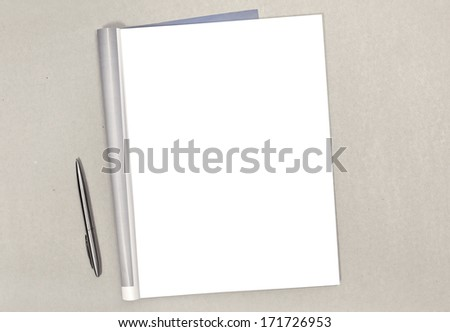 Blank open magazine isolated on textured background - stock photo