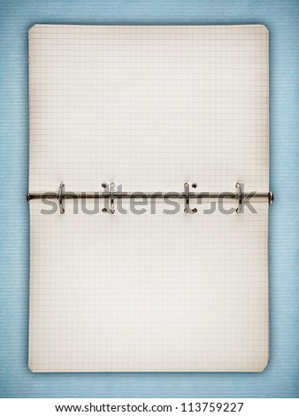 Blank open notebook on blue vintage paper - stock photo