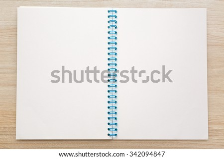 Blank open notepad on the wooden background - stock photo