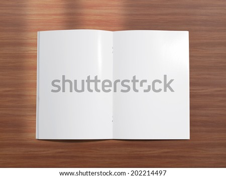 Blank opened brochure photo on wooden background to replace your design - stock photo