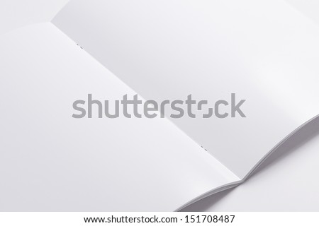 Blank opened magazine isolated on white background with soft shadows. Closer view. - stock photo