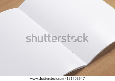 Blank opened magazine on wooden background with soft shadows. Closer view. - stock photo