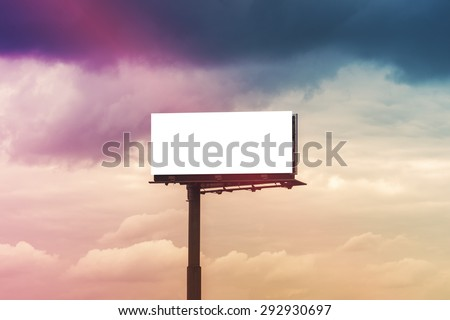 Blank Outdoor Advertising Billboard Hoarding Against Cloudy Sky, White Copy Space for Mock Up Design or Marketing Message - stock photo