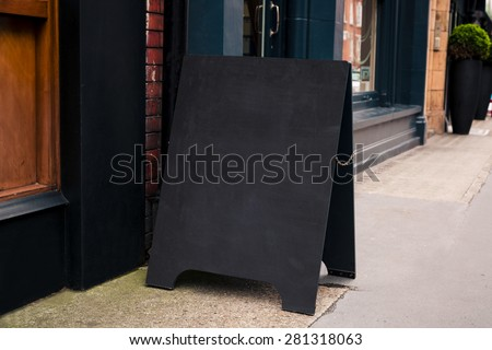 blank outdoor white board at a sidewalk restaurants advertising street sign - stock photo