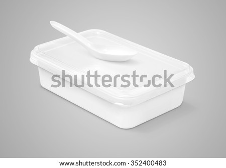 blank packaging plastic box for food and plastic spoon isolated on gray background with clipping path - stock photo