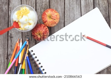 Blank paper and colorful pencils  on wooden table background - stock photo
