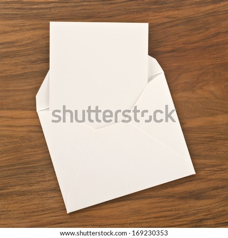 Blank paper and envelope on wooden background  - stock photo