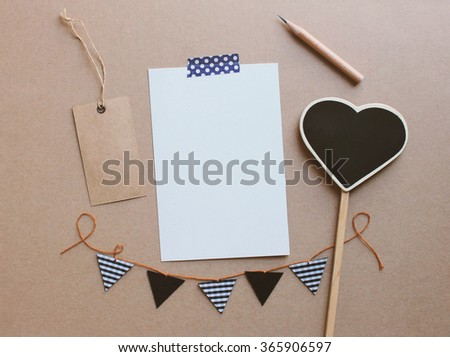 Blank paper card mockup and heart shape blackboard for valentines day - stock photo