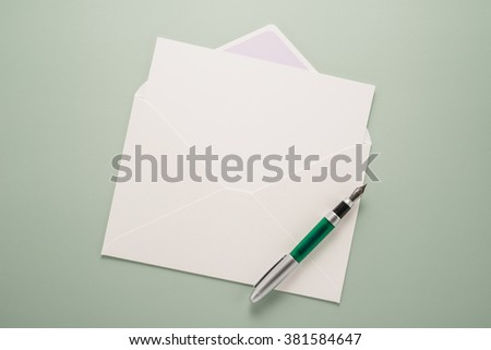 Blank paper, envelope and pen  - stock photo