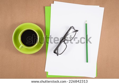 Blank paper, glasses and colorful pencils on the wooden table. View from above  - stock photo