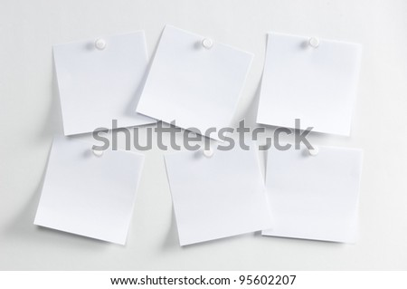 Blank paper, hanging on the wall with a pushpin - stock photo