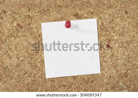 blank paper note pinned on a cork background - stock photo