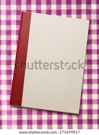 Blank paper notebook on the checked background - stock photo