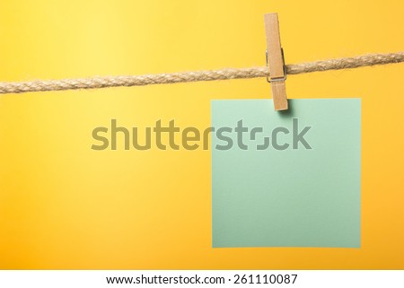Blank paper notes hanging on rope with clothes pins, copy space for text or image or product placement. Reminder - stock photo