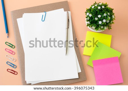 blank paper on desk / Open blank white paper notebook with copy space and a pen lying on a desk, view from above / for your text or message / top view - stock photo