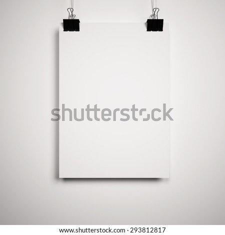 Blank paper poster on white wall - stock photo