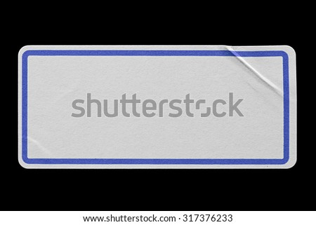 Blank Paper Tag or Label with Blue Border isolated on Black Background. Sticker or Paper Adhesive with Wrinkles and Scratches. Close Up. Top View with Copy Space for Text or Image - stock photo