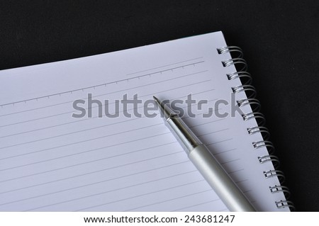 Blank Paper With Pen On Black Background,selective Focus - stock photo