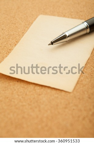 Blank paper with pen on wood background. - stock photo