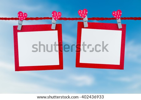 Blank paper with rope on blue sky background. - stock photo