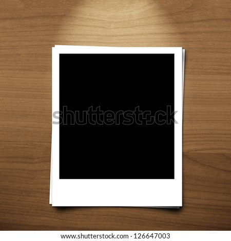 blank photo frame on brown wood background with lighting lamp - stock photo