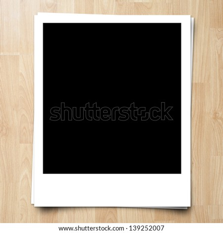 blank photo frame on brown wood plank background - stock photo