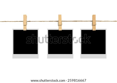 blank photo frame on cloth line isolated white background - stock photo