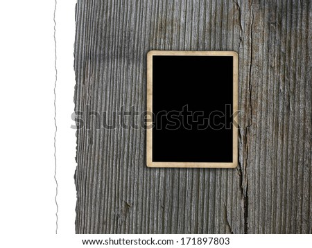 Blank photo frame on grunge wood texture - stock photo