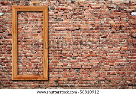 blank photo frame on old brick wall - stock photo