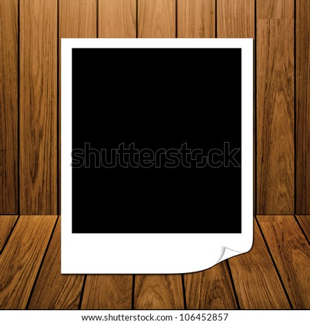 blank photo frame on wall and floor siding wood background - stock photo