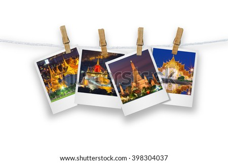 Blank photo frame  with clothespin hanging, photo landmark of Bangkok, Isolated on white with clipping path. - stock photo