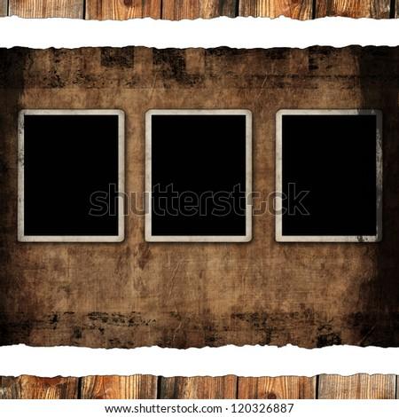 Blank photo frames on aged background - stock photo
