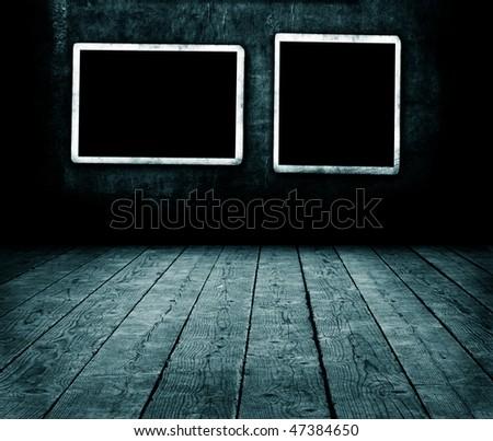 Blank photo frames on wall - stock photo