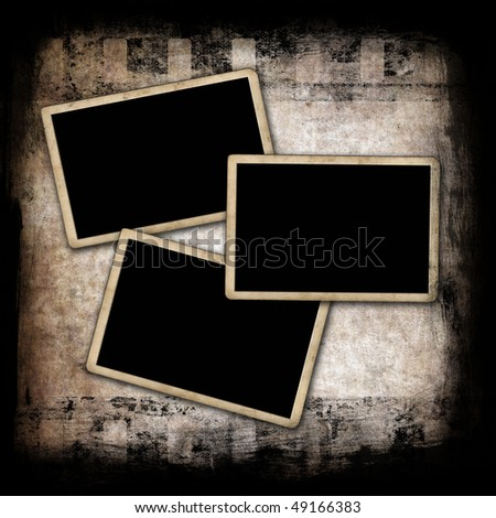 Blank photo frames on wall with film strip background - stock photo